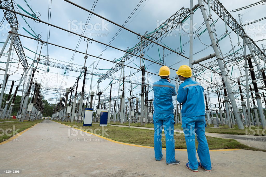 Substation workers stock photo