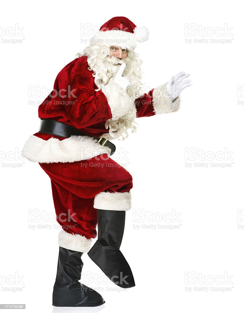 Subtly sneaking Santa stock photo