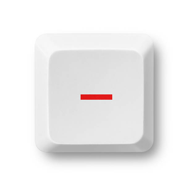 Subtraction computer key isolated on white Minus red symbol on a white computer key isolated on white. Key'™s clipping path included. The red color of the minus sign can be easily modified in photoshop by moving the Hue/Saturation slider without affecting the rest of the image.  minus sign stock pictures, royalty-free photos & images