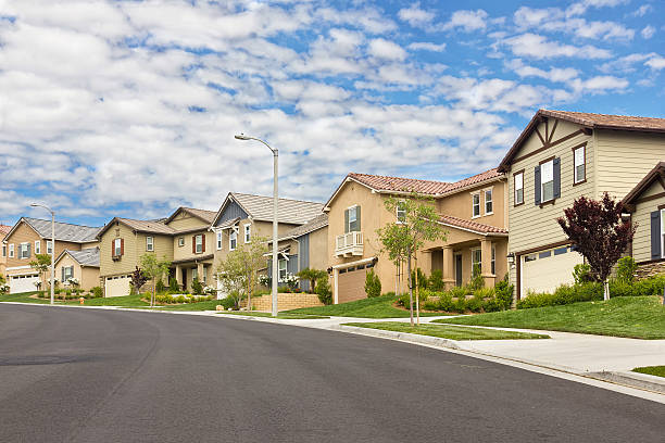 suburb homes - suburban street stock photos and pictures