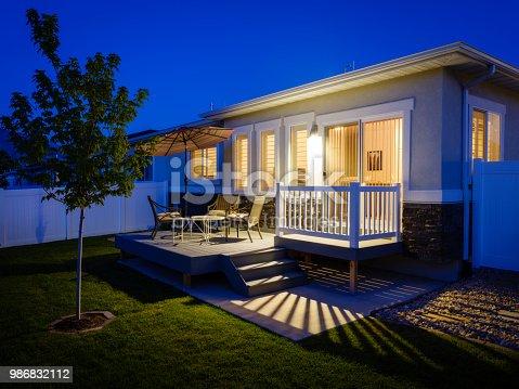A suburban USA home backyard and patio at dusk.