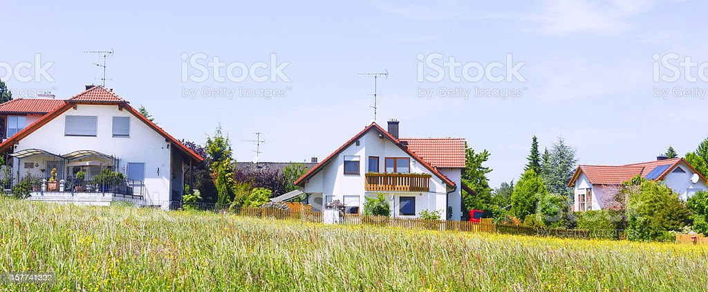 suburb houses with meadow royalty-free stock photo