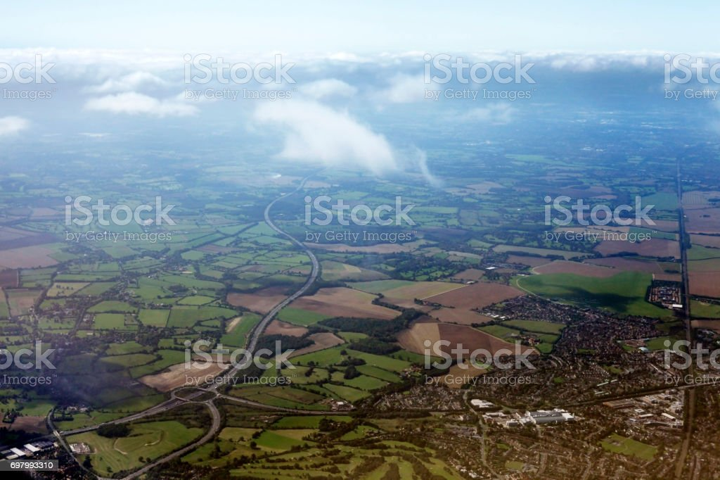 Suburb of London through a window of the plane stock photo