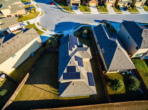 Suburb Texas Homes With Rooftop Solar Panels Stock Photo - Download Image Now