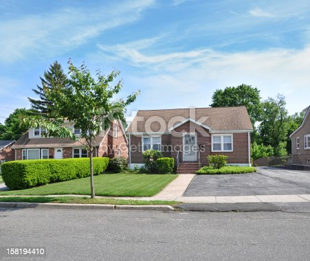 American Dream Suburban Bungalow Cottage Middle Class Home Sunny Blue Sky Day