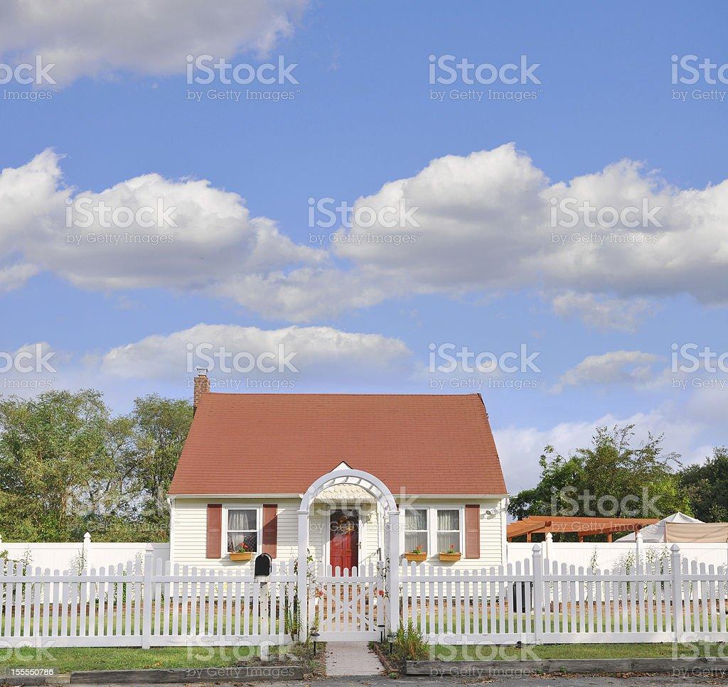 Suburban Bungalow Home White Picket Fence stock photo