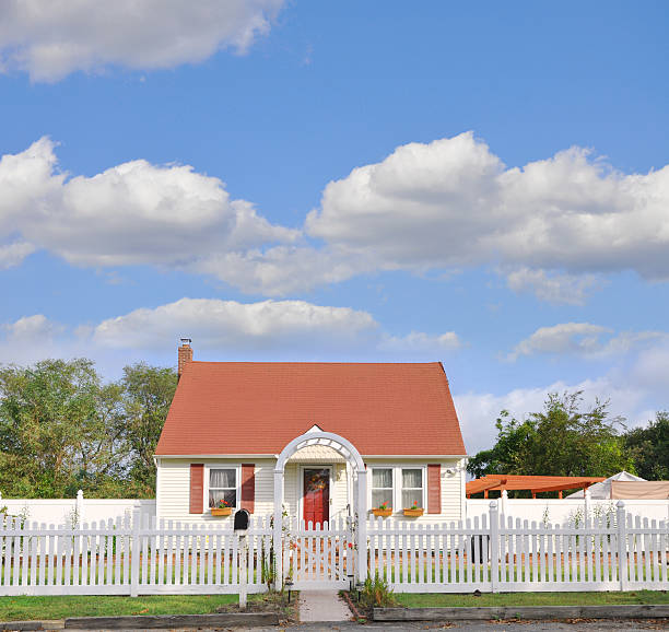 Suburban Bungalow Home White Picket Fence Suburban one story country Bungalow Home White Picket Fence during morning daylight bungalow stock pictures, royalty-free photos & images