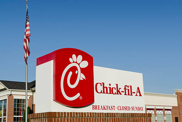 Suburban Chick-fil-A Sign and Restaurant with Copy Space stock photo