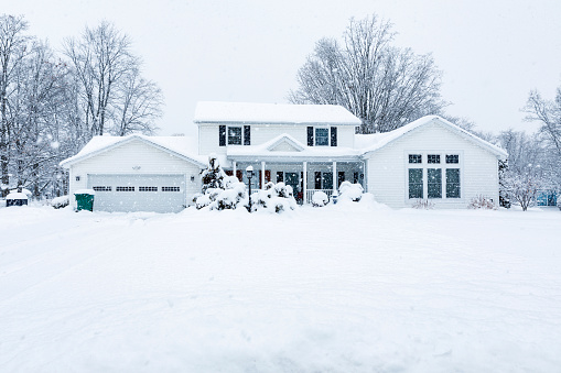 Suburban Colonial Home During Extreme Blizzard Snow Storm