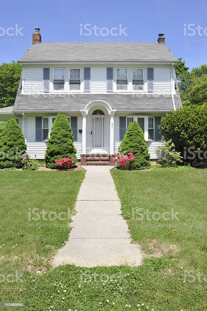 Suburban Colonial Home Walkway Sunny Blue Sky Day stock photo