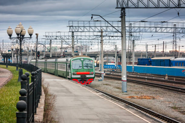 Suburban electric train at the railway station Suburban electric train at the railway station electric train stock pictures, royalty-free photos & images