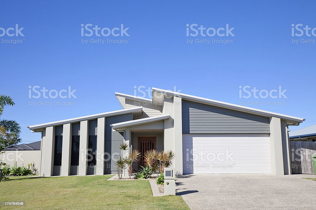 Suburban Family Home clear blue sky copyspace stock photo