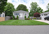 istock Suburban Home Cottage Front Yard Lawn 153967550