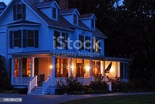 Manchester, VT, USA October 10,. 2012 The lights are on at dusk at a Victorian home in Manchester, Vermont