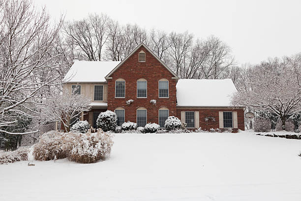 Suburban Home on a Snowing Winter Day stock photo