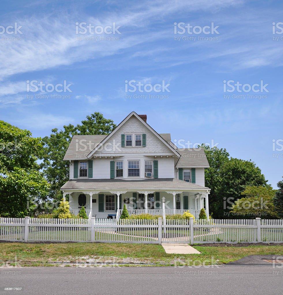 Suburban Home White Picket Fence stock photo