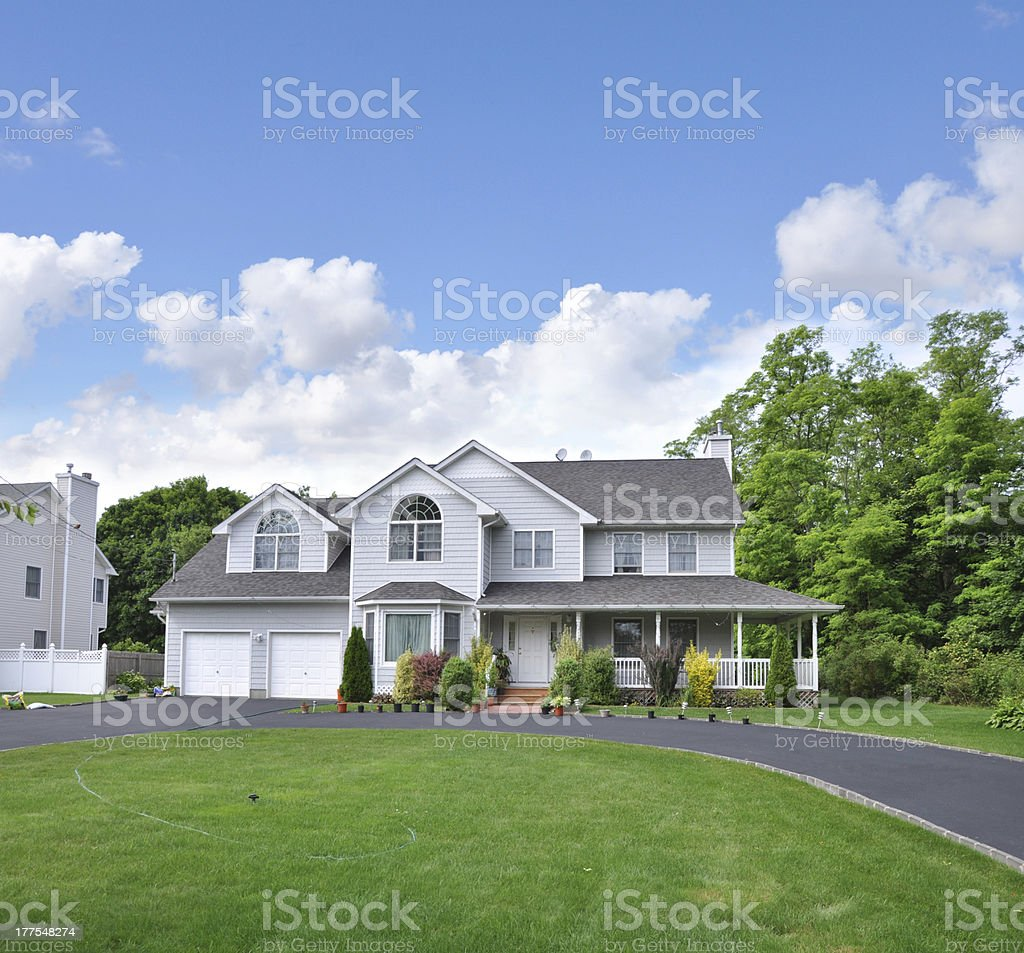 Suburban Home with circular blacktop driveway stock photo