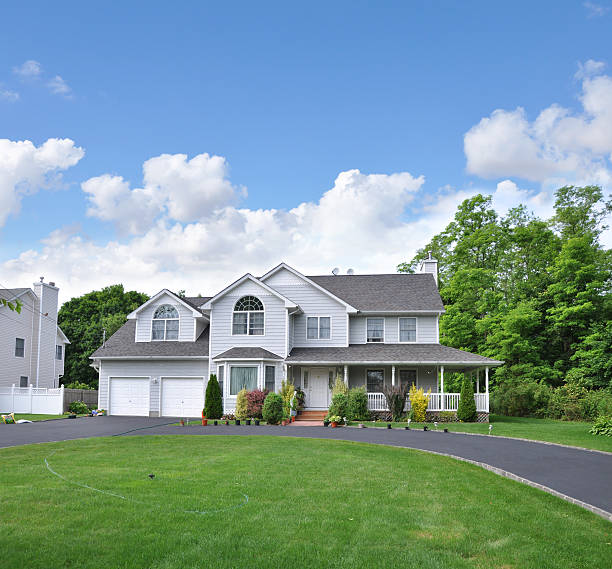 Suburban Home with circular blacktop driveway stock photo