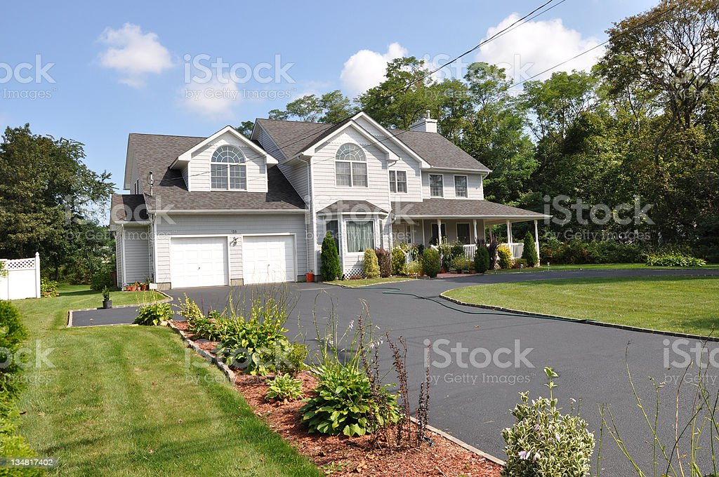 Suburban Home with Long Driveway Two Car Garage stock photo