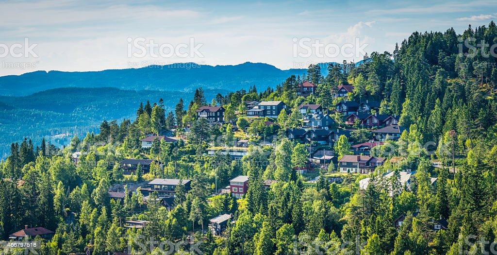 Suburban homes panorama on green wooded hillside Oslo Norway stock photo