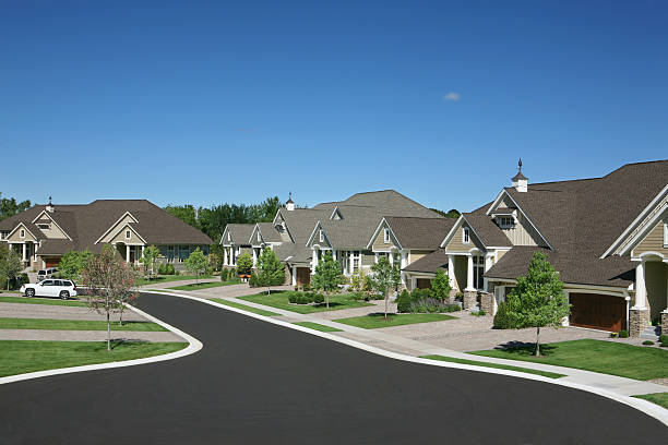 Suburban Houses Perfectly manicured suburban street. gated community stock pictures, royalty-free photos & images