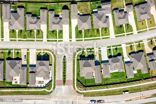 A large group of middle class homes in a suburban Houston, Texas neighborhood shot from an altitude of about 1000 feet.