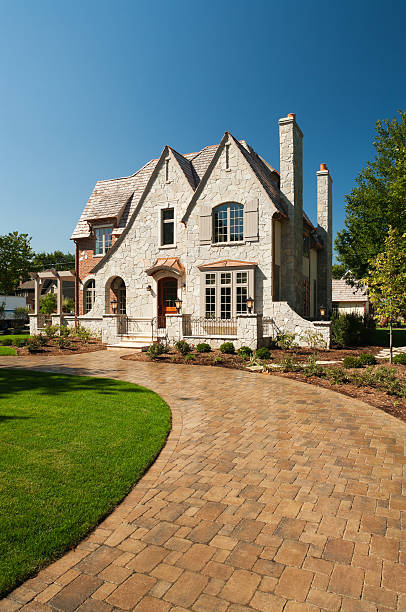 Suburban mansion with paver driveway. stock photo