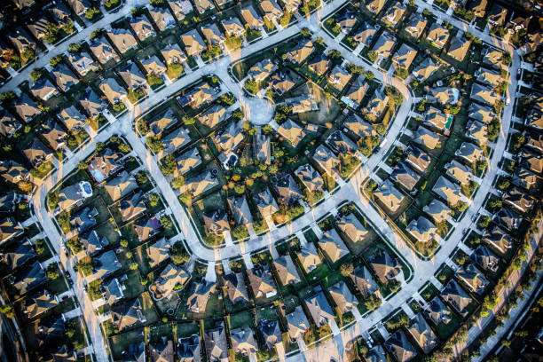 Suburban Master Planned Community Aerial Aerial view of a residential subdivision in the suburbs of Houston, Texas consisting of large luxury homes and manicured landscaping. urban sprawl stock pictures, royalty-free photos & images