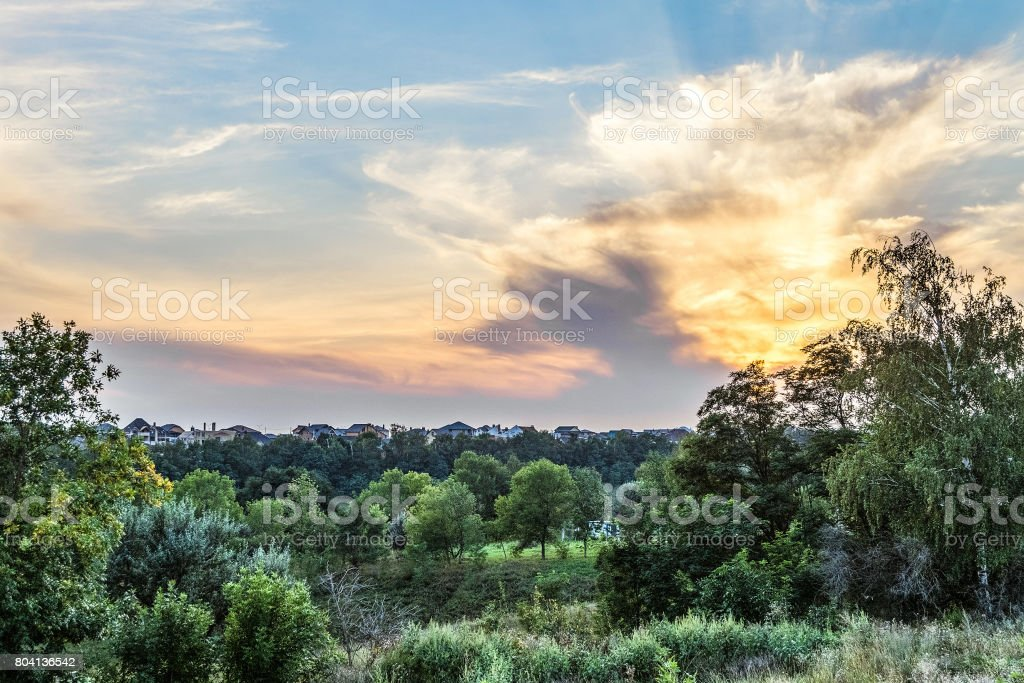 Suburban skyline at sunset. Buildings individual suburban housing in the eco-friendly green district. stock photo