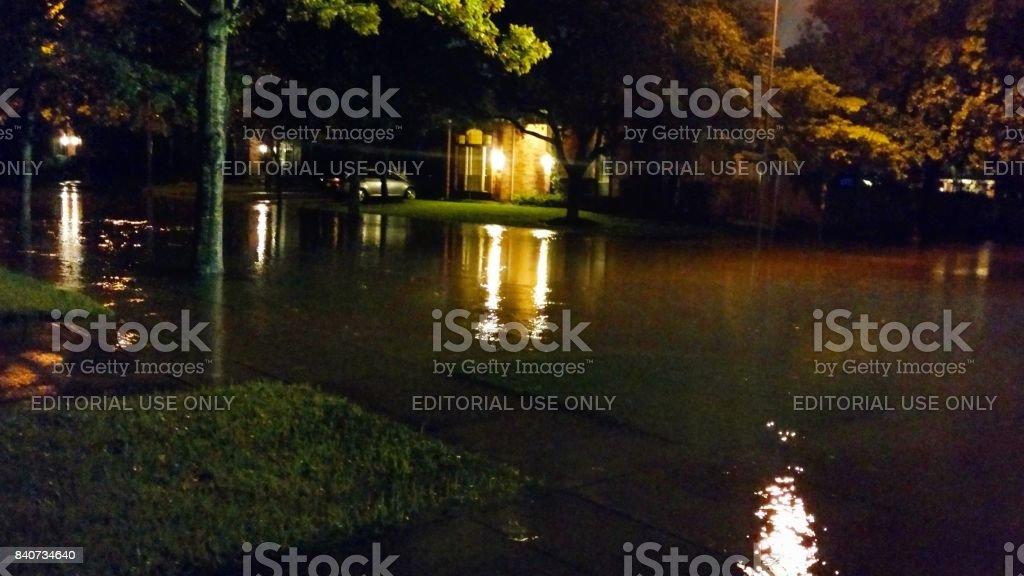 Suburban Street Flooded at Night by Hurricane Harvey stock photo
