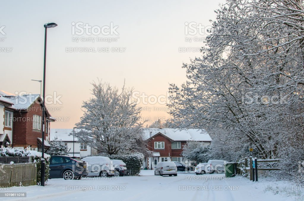 A suburban street on a snowy day stock photo