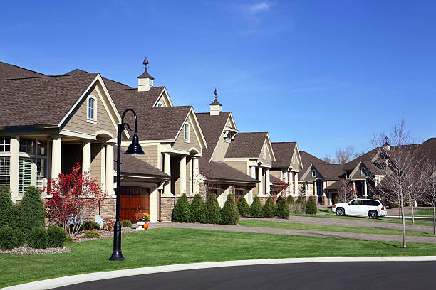 Suburban Street Perfectly manicured suburban street. gated community stock pictures, royalty-free photos & images