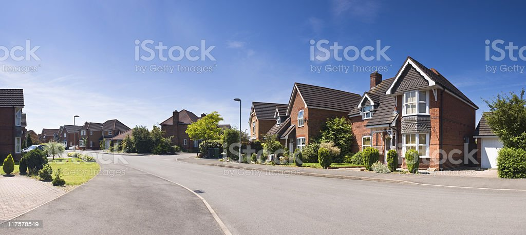 A suburban street scene from a pedestrians perspective stock photo
