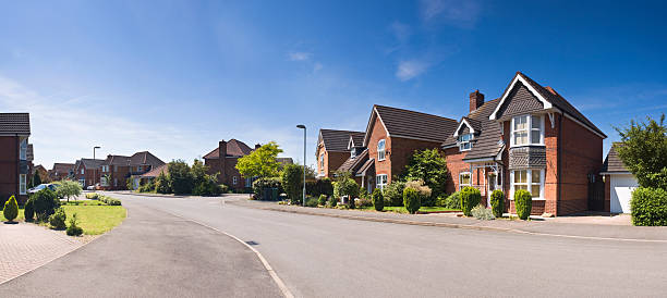 a suburban street scene from a pedestrians perspective - suburban street stock photos and pictures