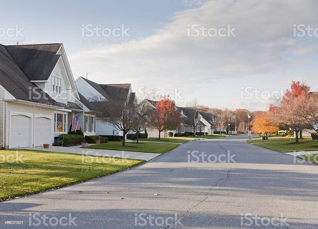 Suburban Street with Uniform Residential Housing royalty-free stock photo
