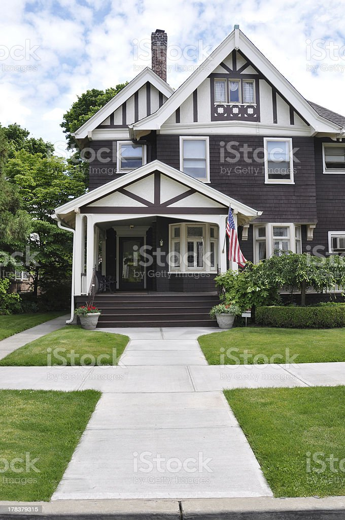 Suburban Victorian Home American Flag stock photo