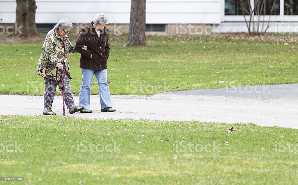 Suburban Walking Senior Mother and Mature Daughter royalty-free stock photo