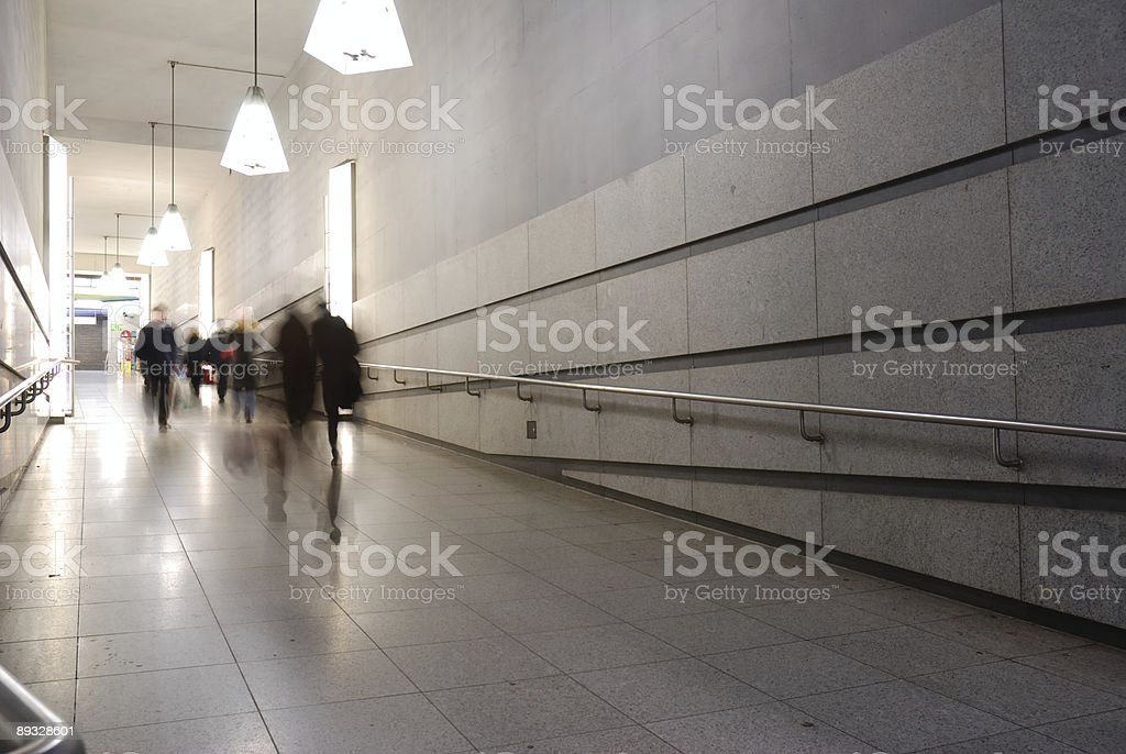 subway corridor with pedestrians, motion blur royalty-free stock photo