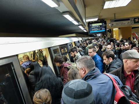 Bucharest, Romania, 1 February 2016: People travel with metro train at a rush hour in Bucharest.