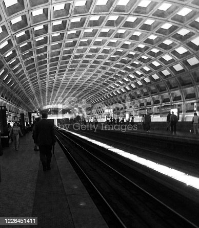 Black and white of a subway platform