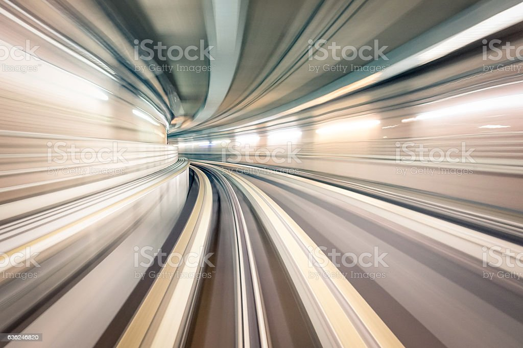 Subway metro underground tunnel with blurry rail tracks in gallery stock photo