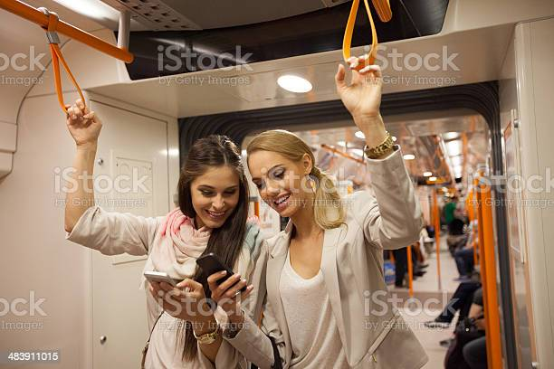 Subway Passengers With Smart Phones Stock Photo - Download Image Now