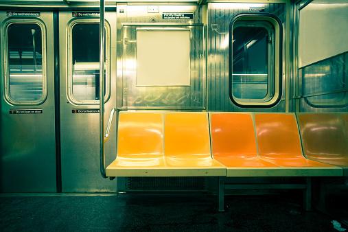 Vintage toned image of empty New York City subway car