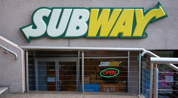subway restaurant entrance exterior. subway is an american fast food restaurant franchise that sells submarine sandwiches and salads. - food logo stock photos and pictures