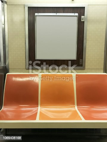 Subway seats and blank billboard in New York