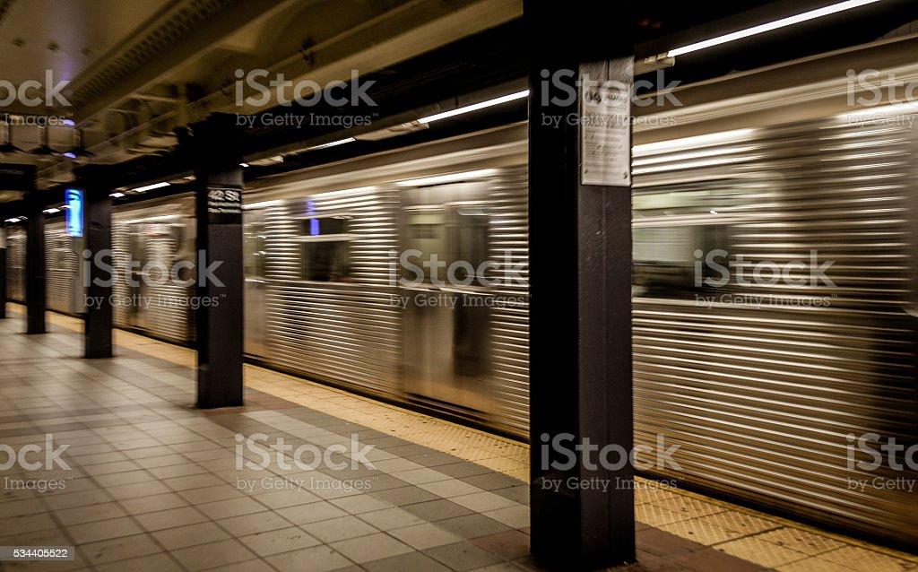 Subway station and passing train - New York City stock photo