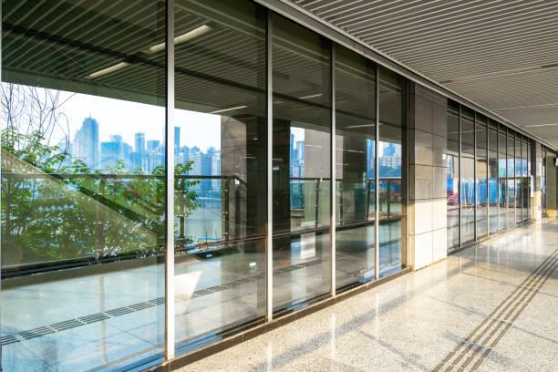 Subway station entrance sidewalk and glass windows stock photo