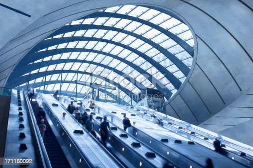 subway station with escalators and blurred people, Canary Wharf, London, UK,click here to view more related images: