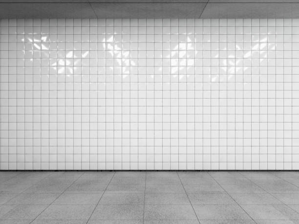 Subway station interior. Abstract urban space, empty white tiled wall with concrete floor and ceiling. Side view with copy space to your advertision. Mock up. 3d render. underground stock pictures, royalty-free photos & images