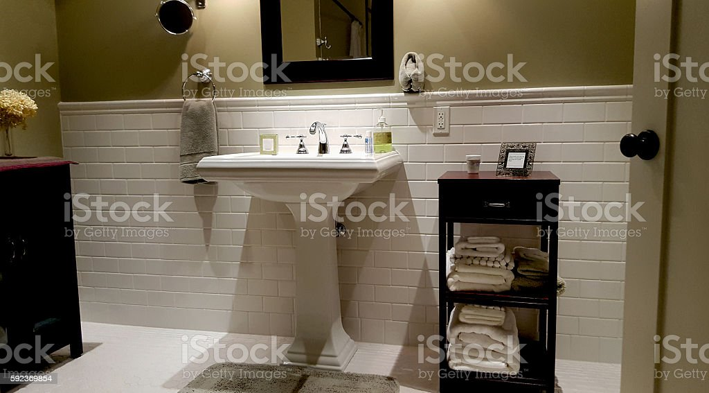 Subway Tiles And Pedestal Sink In New Modern Bathroom stock photo